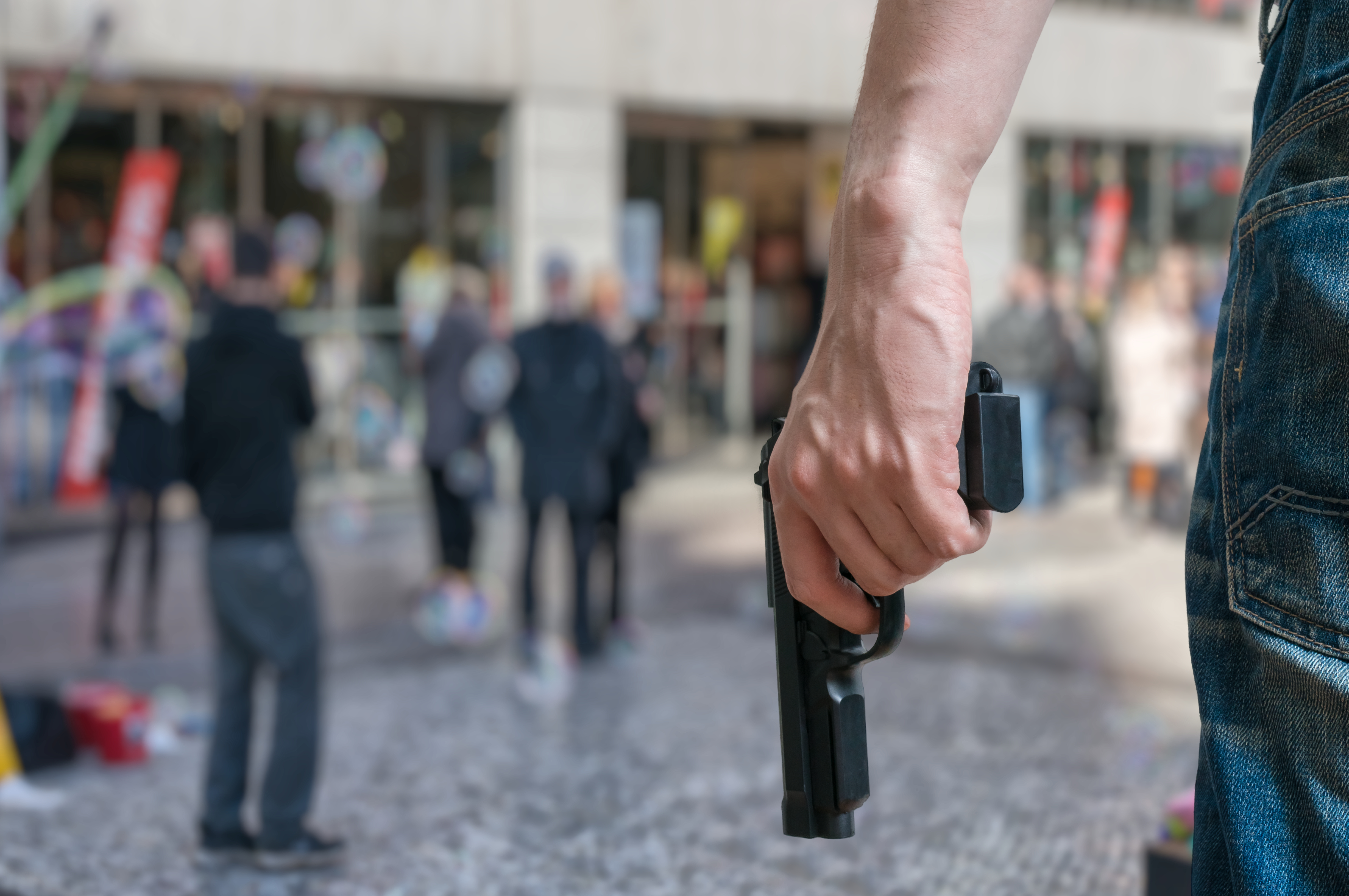 People with guns sometimes use them to shoot others arbitrarily.